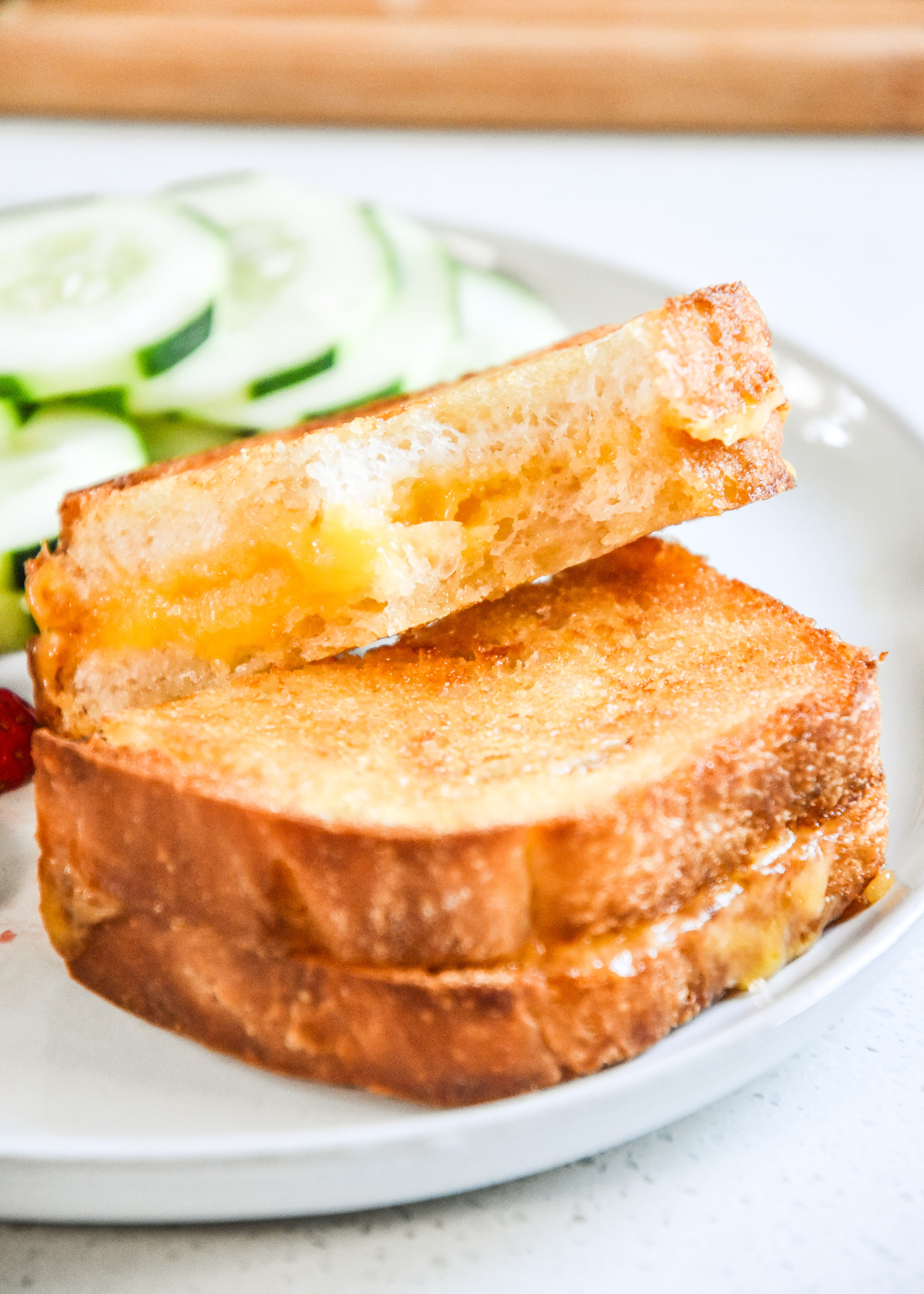 air fryer grilled cheese sandwich with a bite out of it