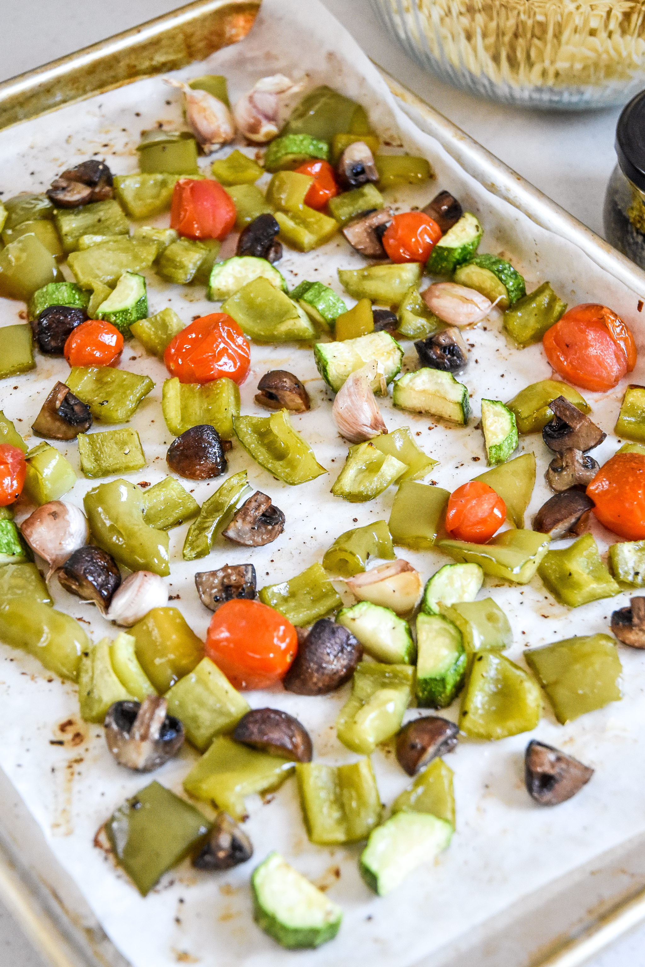roasted veggies on a sheet pan for the pesto pasta salad