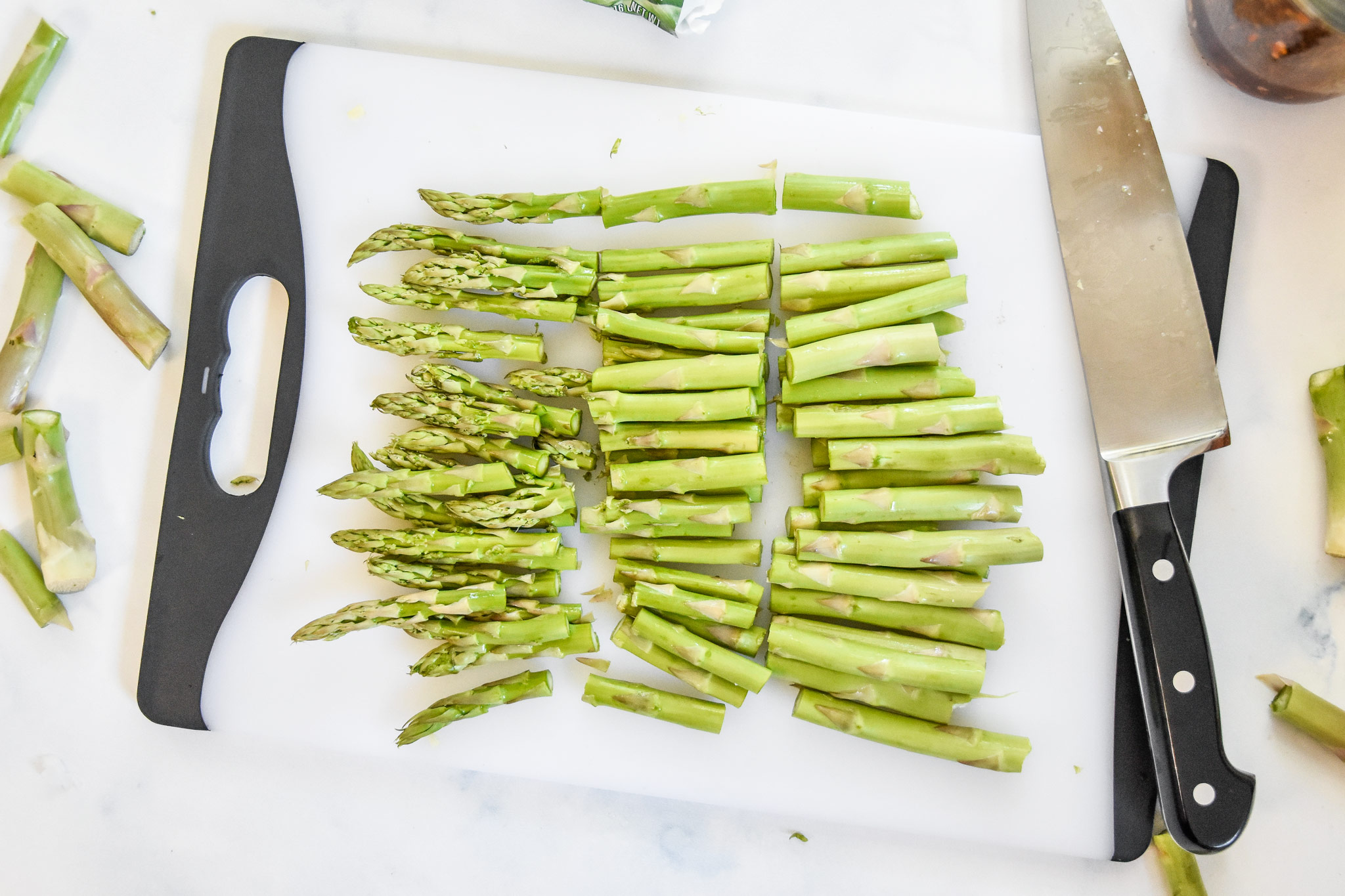asparagus cut into thirds on a cutting board