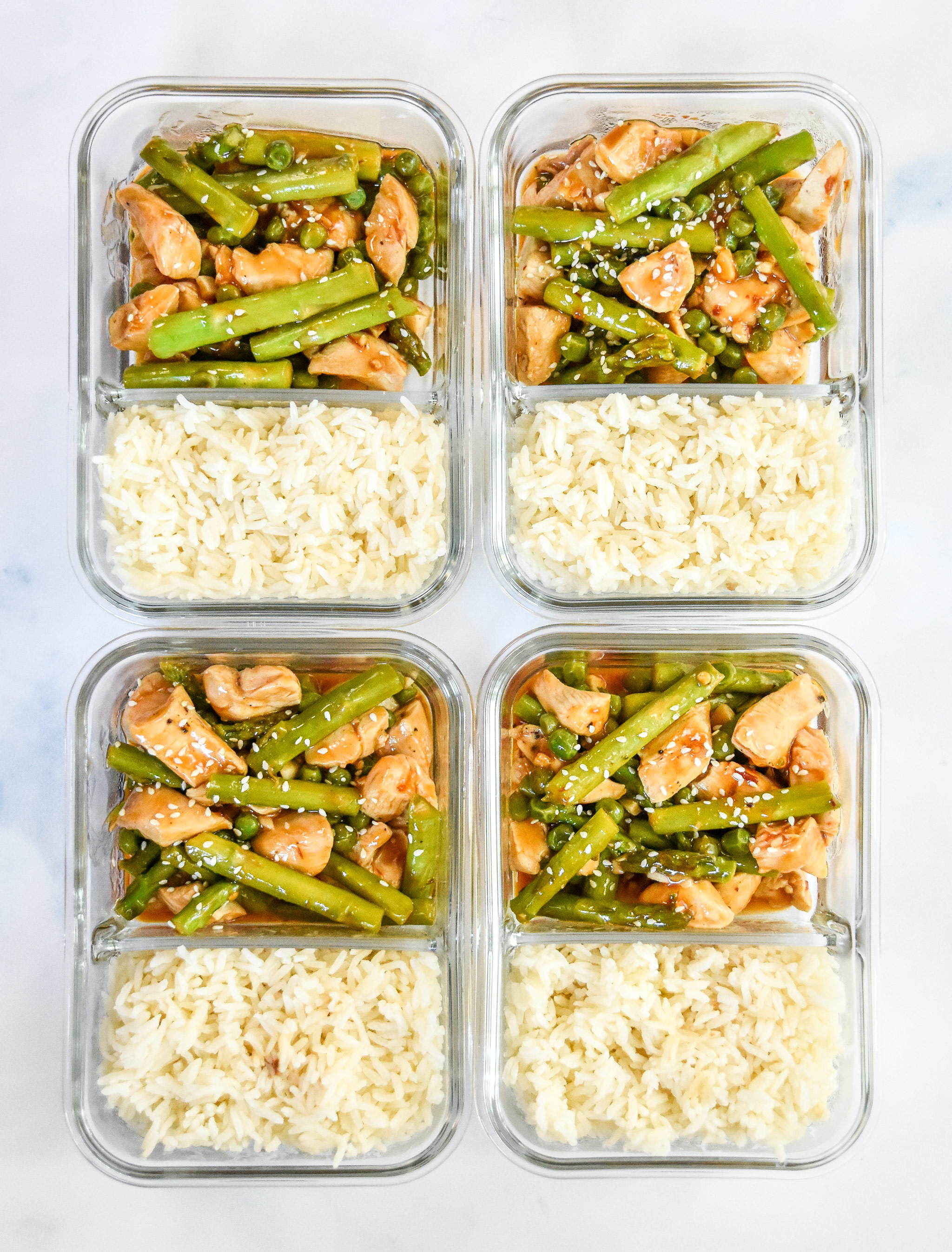 meal prep spicy chicken and asparagus in meal prep containers