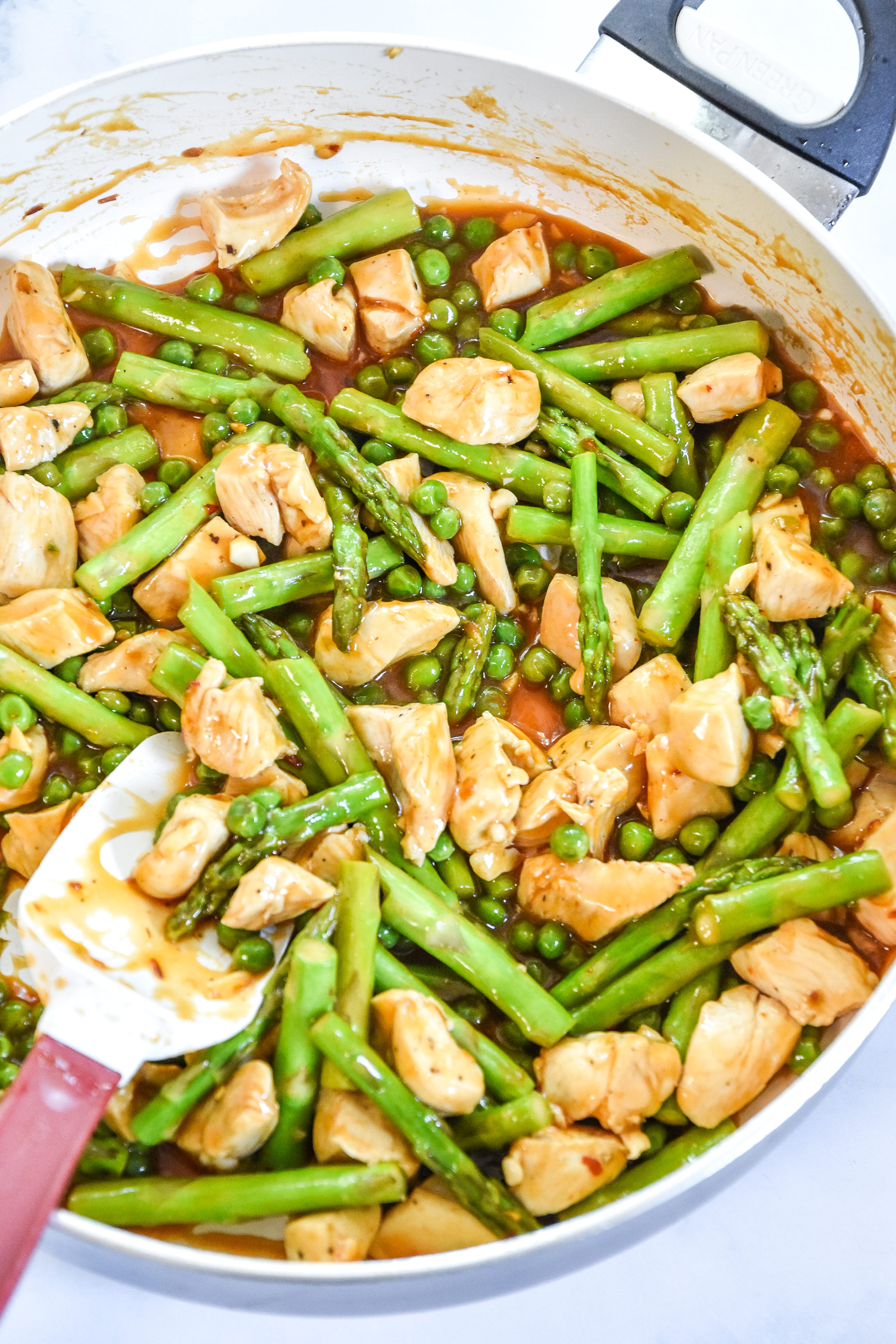 spicy chicken stir fry cooked for the meal prep lunches