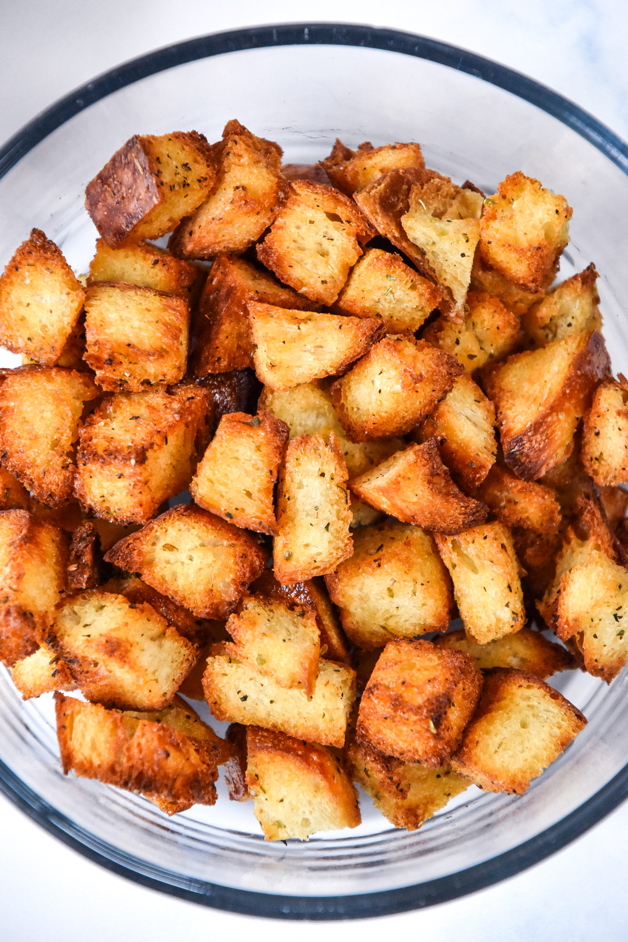 homemade croutons in a bowl for storing.