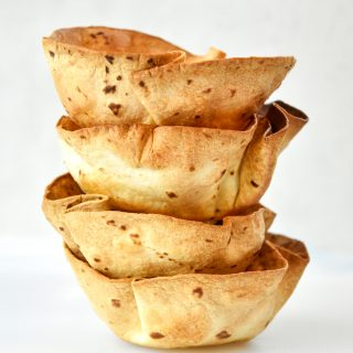 a stack of air fryer flour tortilla bowls.