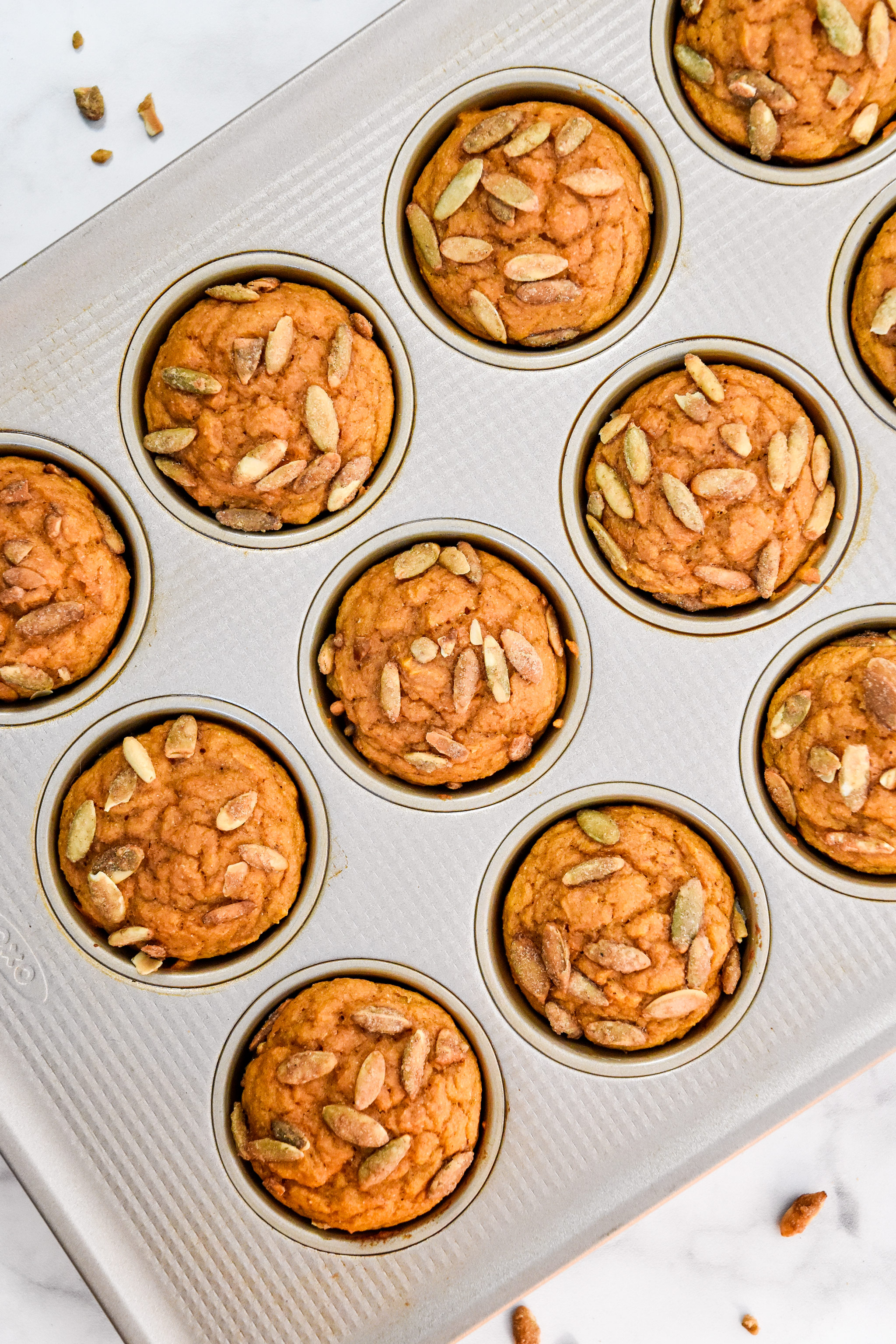 fresh baked pumpkin spice pancake mix muffins cooling in the muffin tin