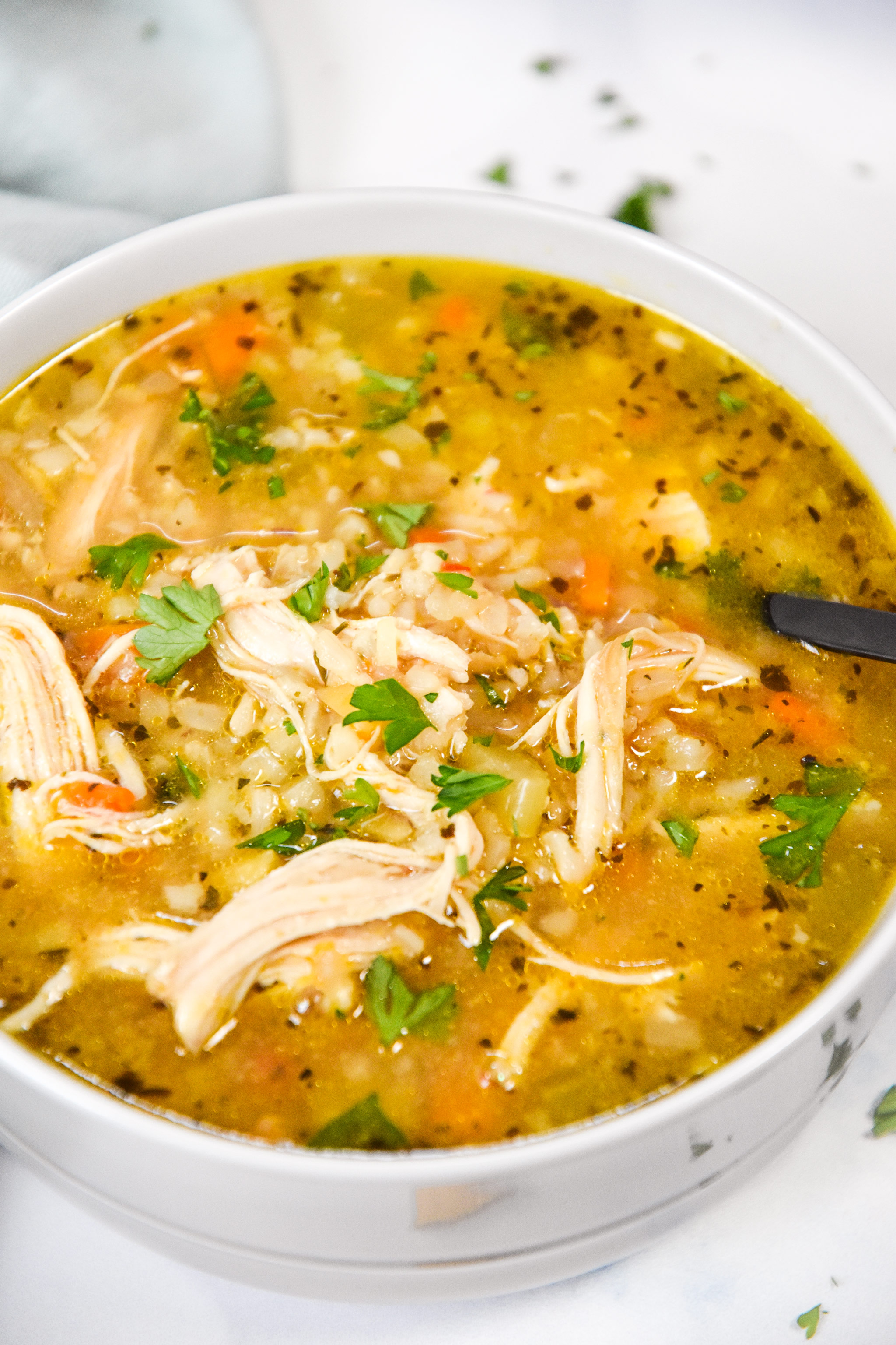 close up bowl of chicken and rice soup.