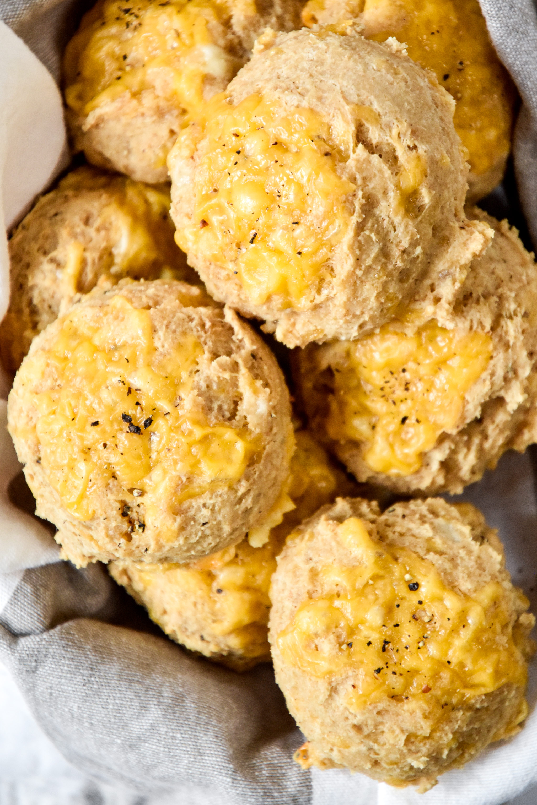 pancake mix cheddar drop biscuits in a basket.