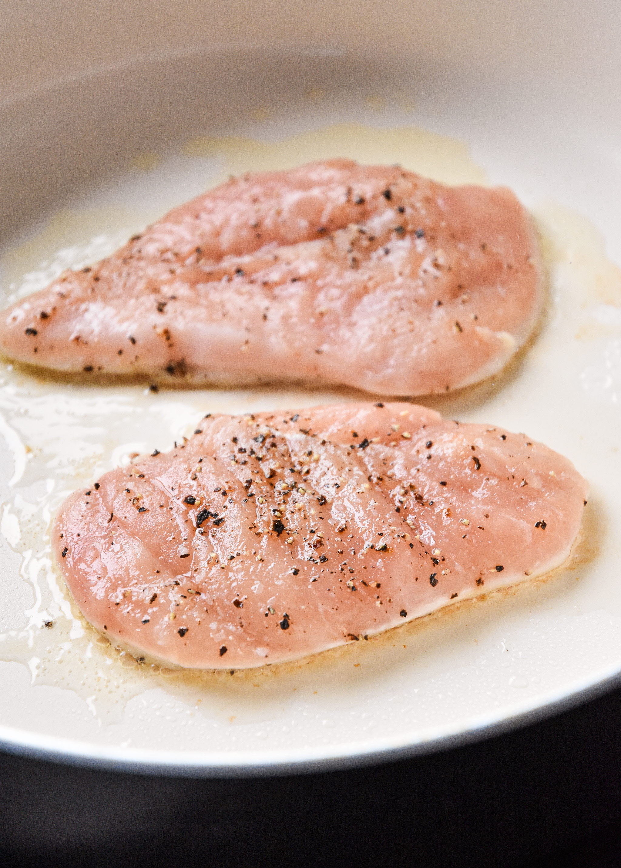 cooking seasoned chicken breast in avocado oil.