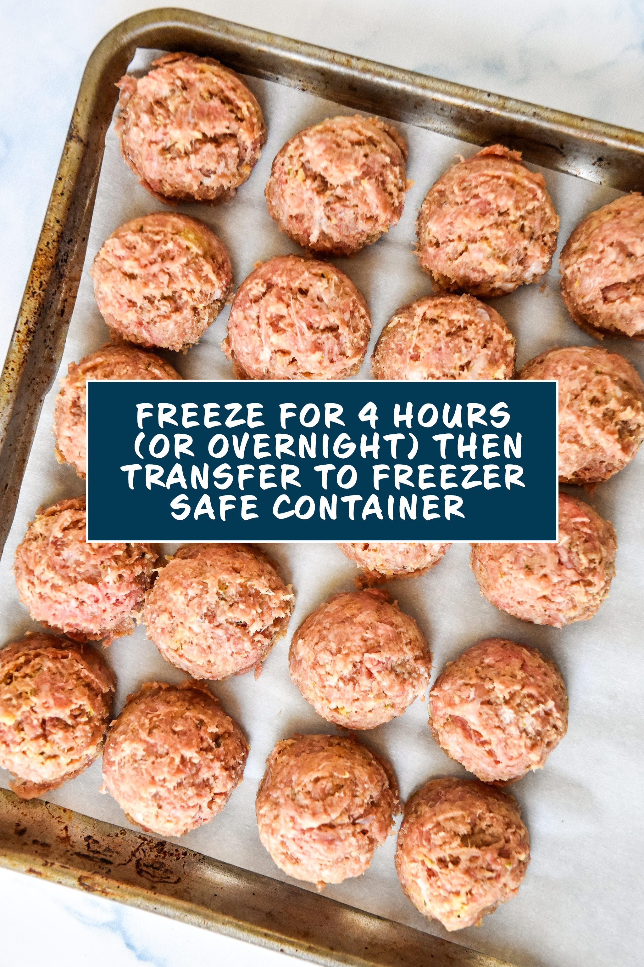 easy freezer friendly meatballs on a sheet pan frozen overnight.