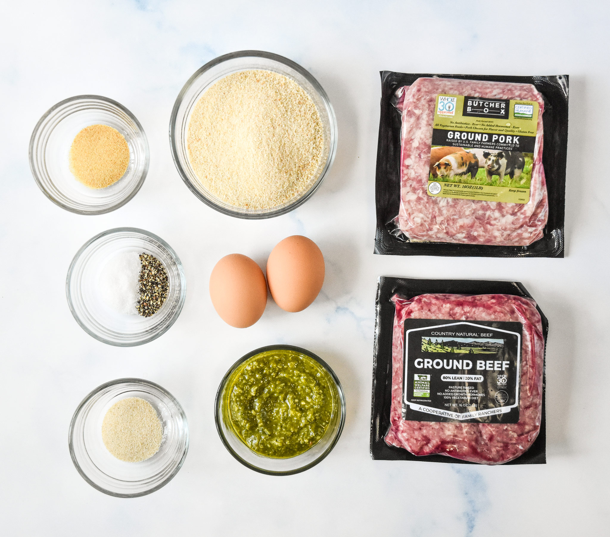 all the ingredients laid out on a counter for the easy freezer friendly meatballs.