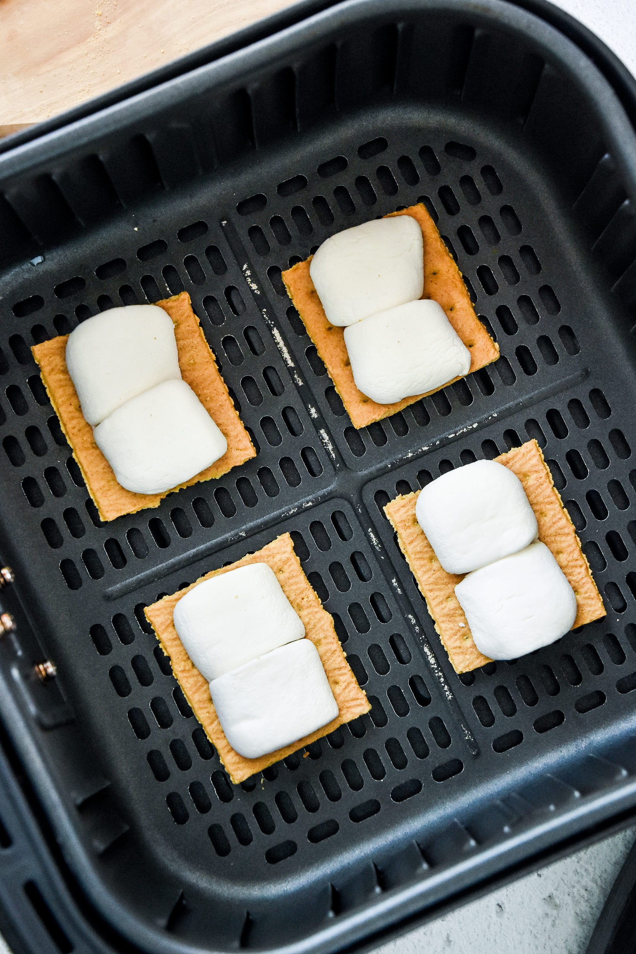 graham crackers with marshmallows in the air fryer basket.