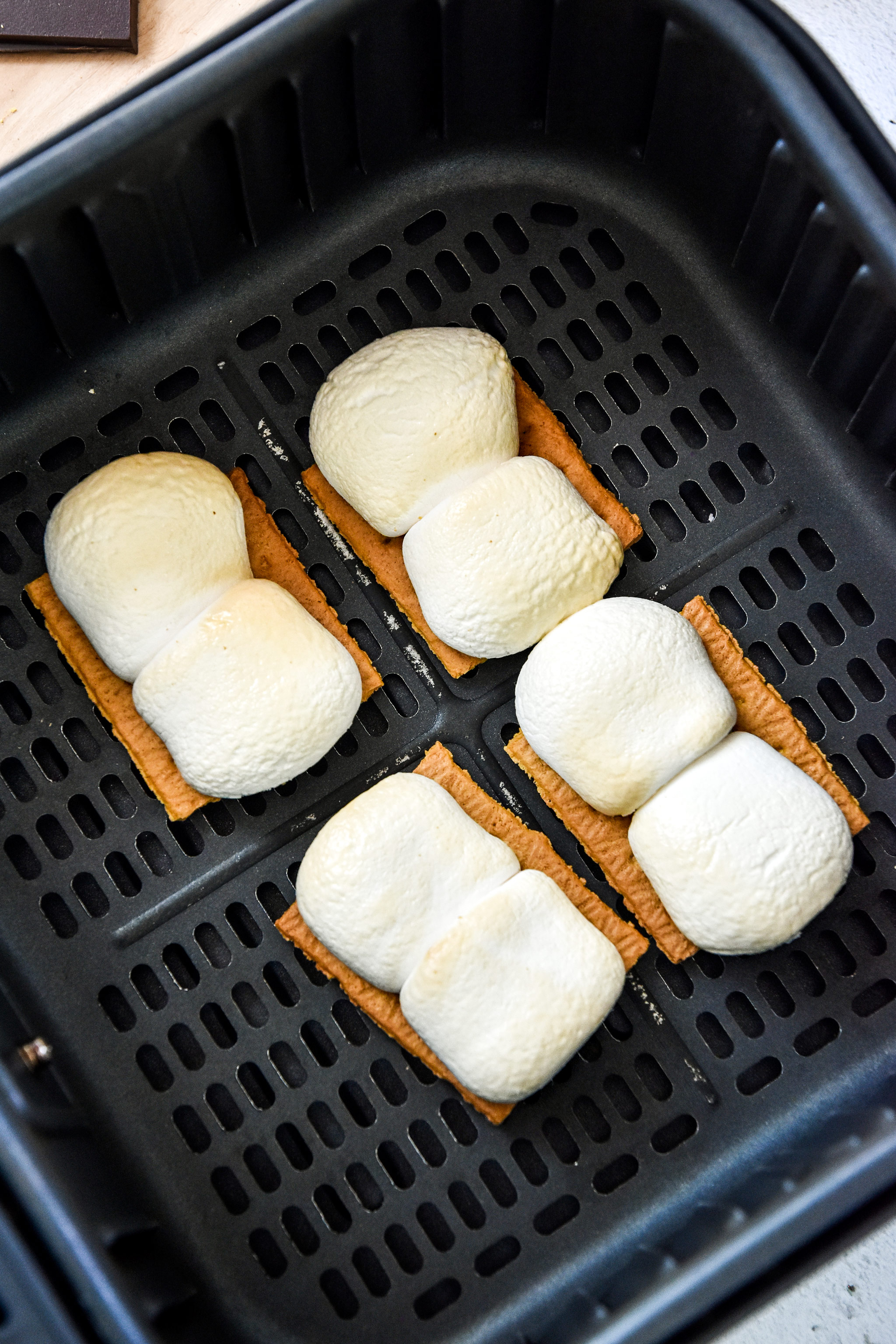cooked marshmallows in the air fryer basket for s'mores.