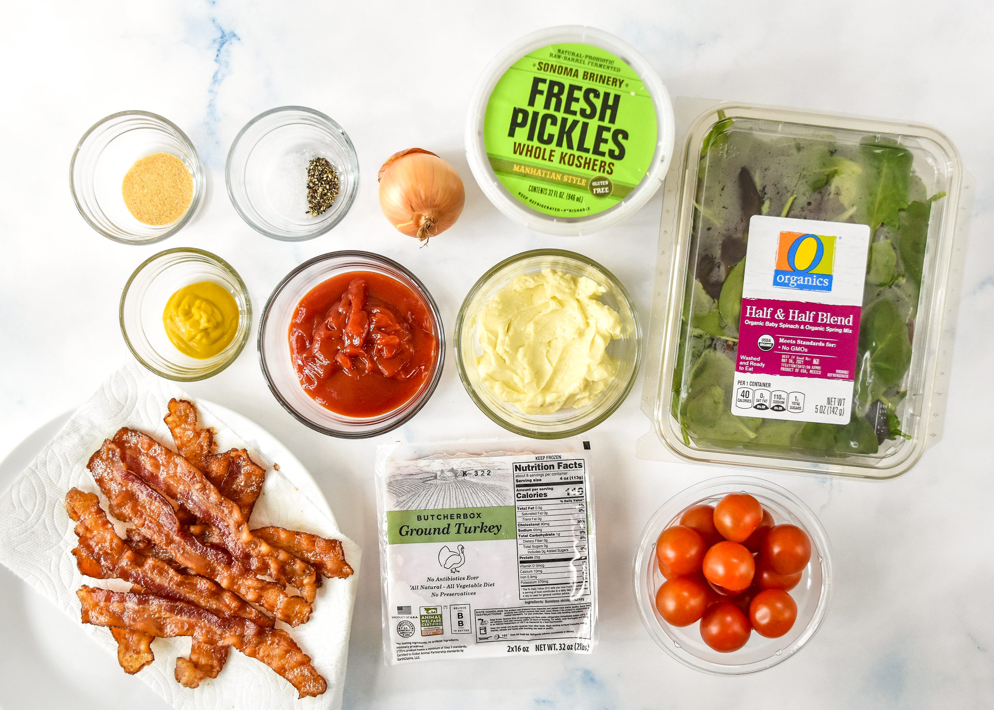ingredients for the loaded ground turkey burger bowls including bacon, lettuce mayo mustard.