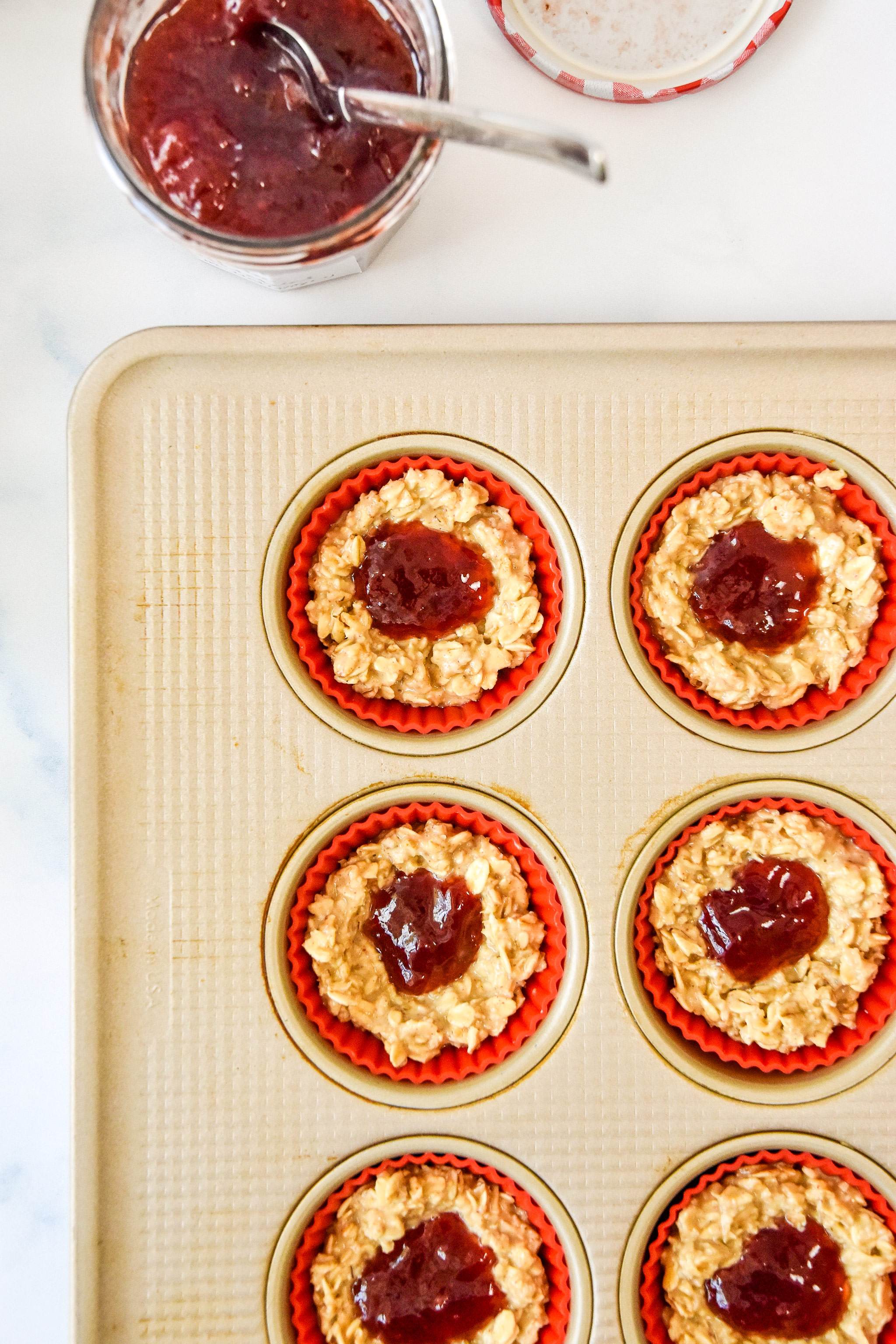 jelly in the center of each oatmeal cup in the muffin tin.