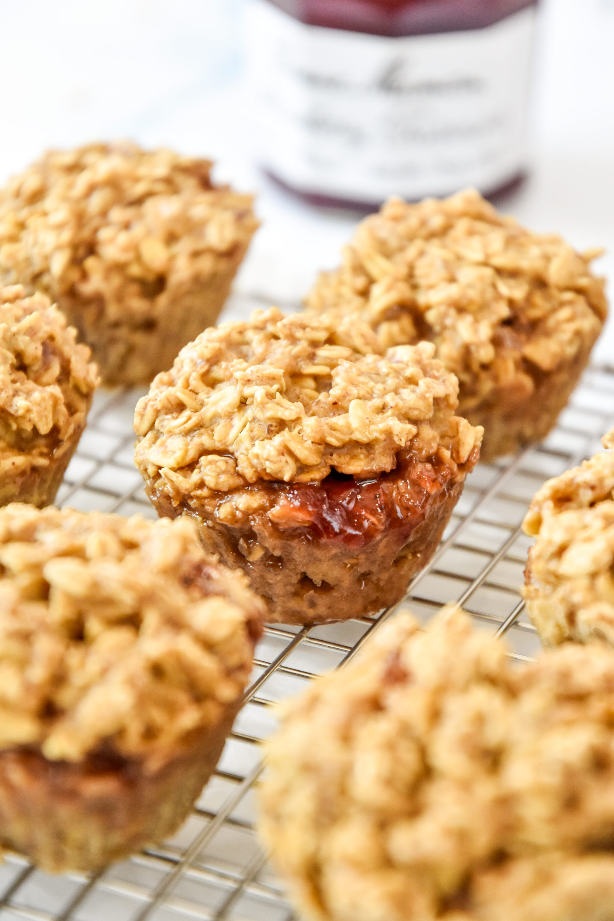 peanut butter & jelly baked oatmeal cups on a cooling rack.