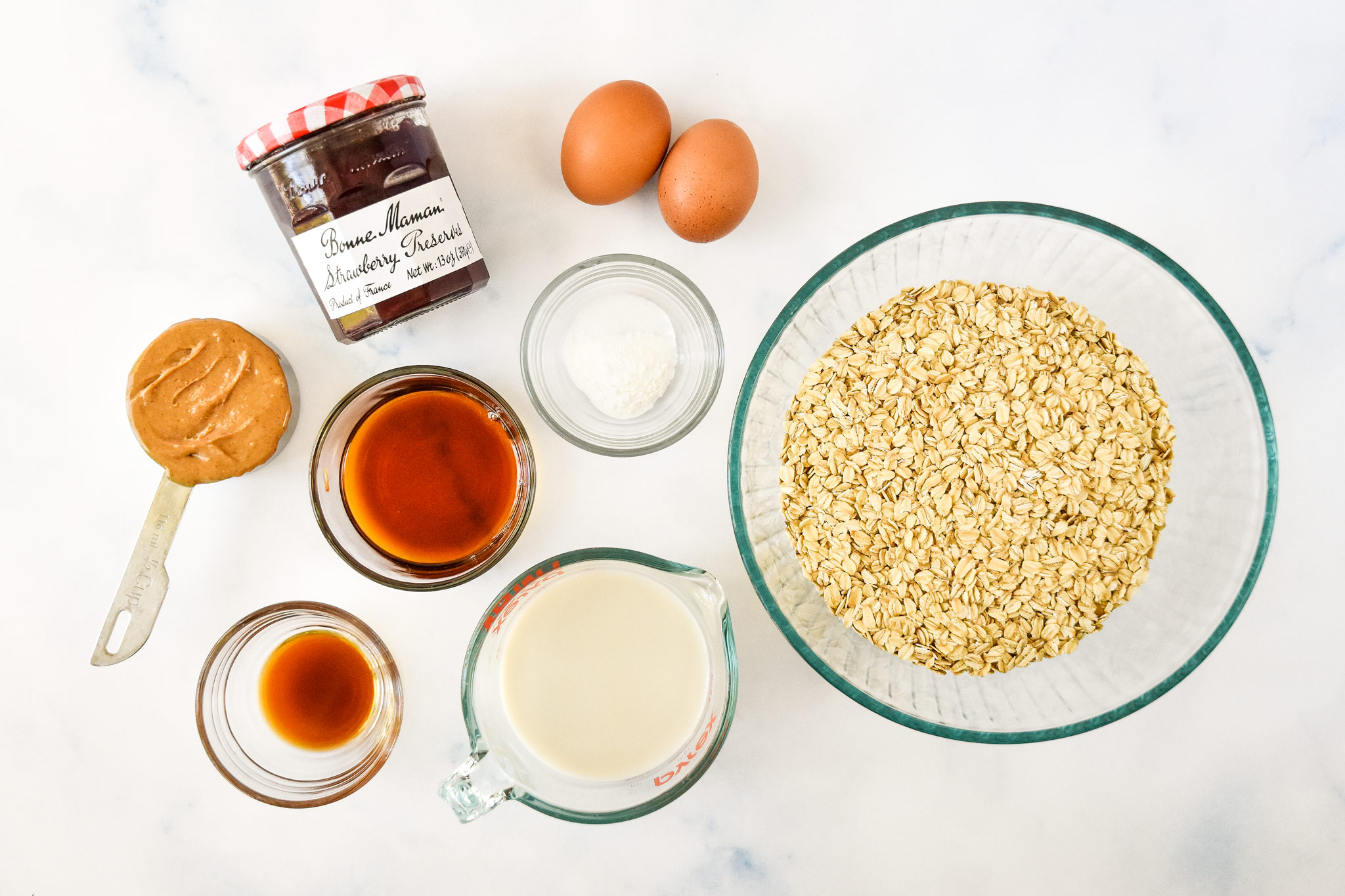 ingredients on a counter top for the pbj baked oatmeal cups.