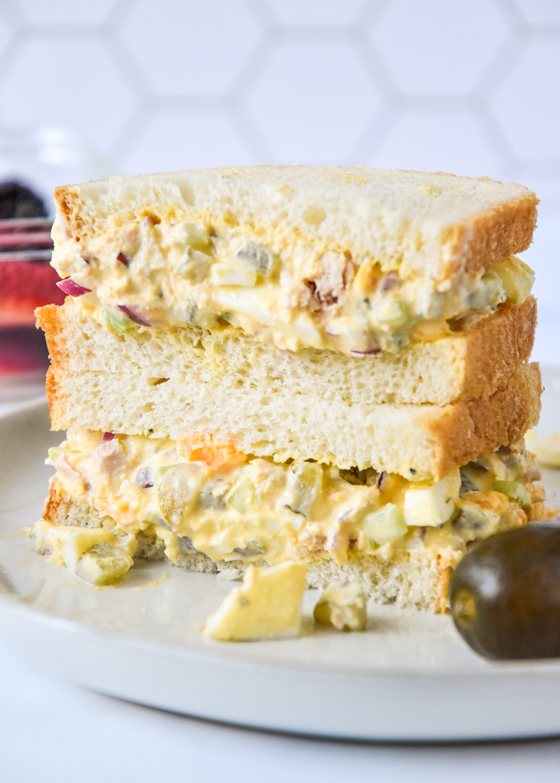 tuna egg salad on white bread cut in half.