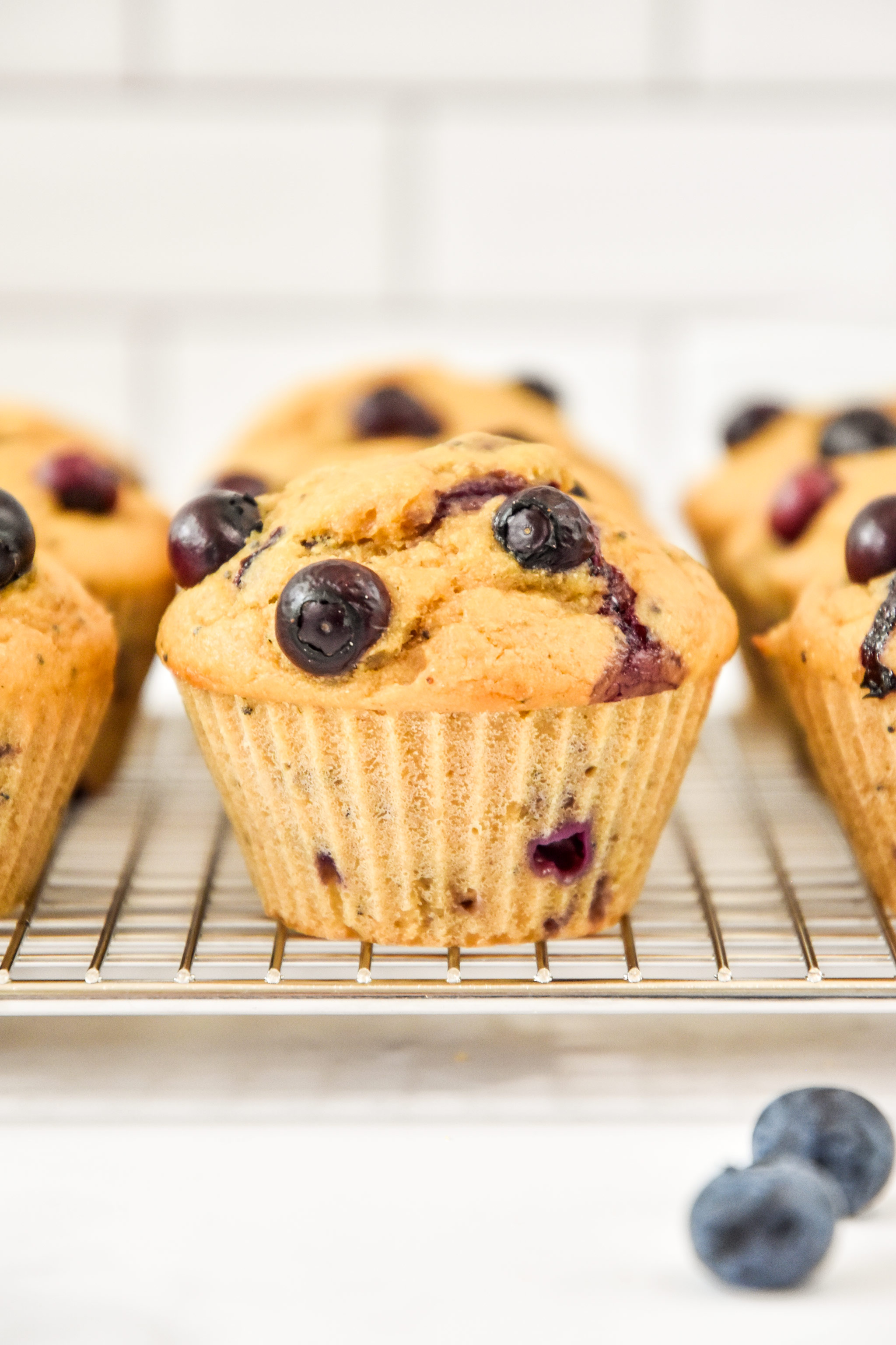 side view of muffins on a cooling rack.