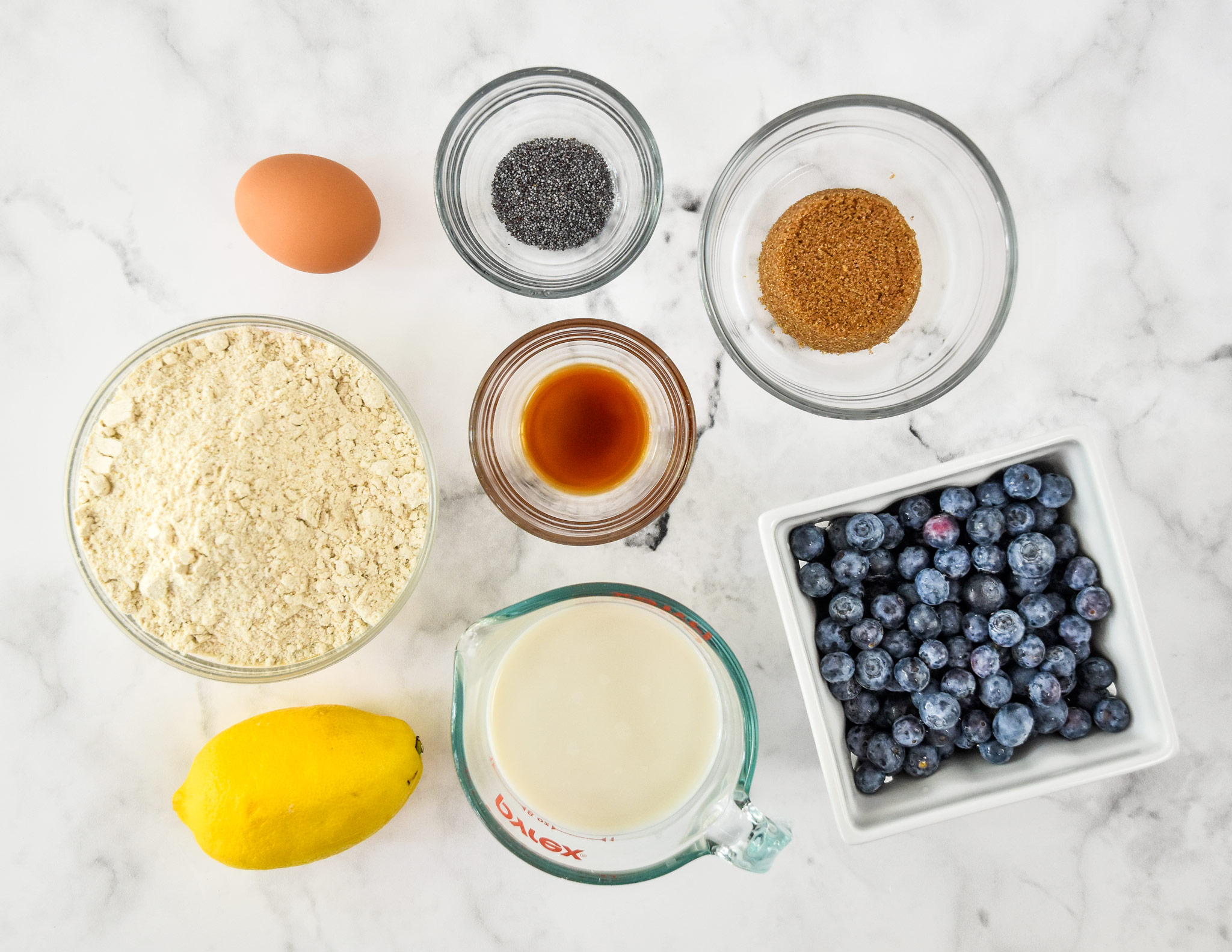 ingredients in the blueberry lemon pancake mix muffins in separate bowls.