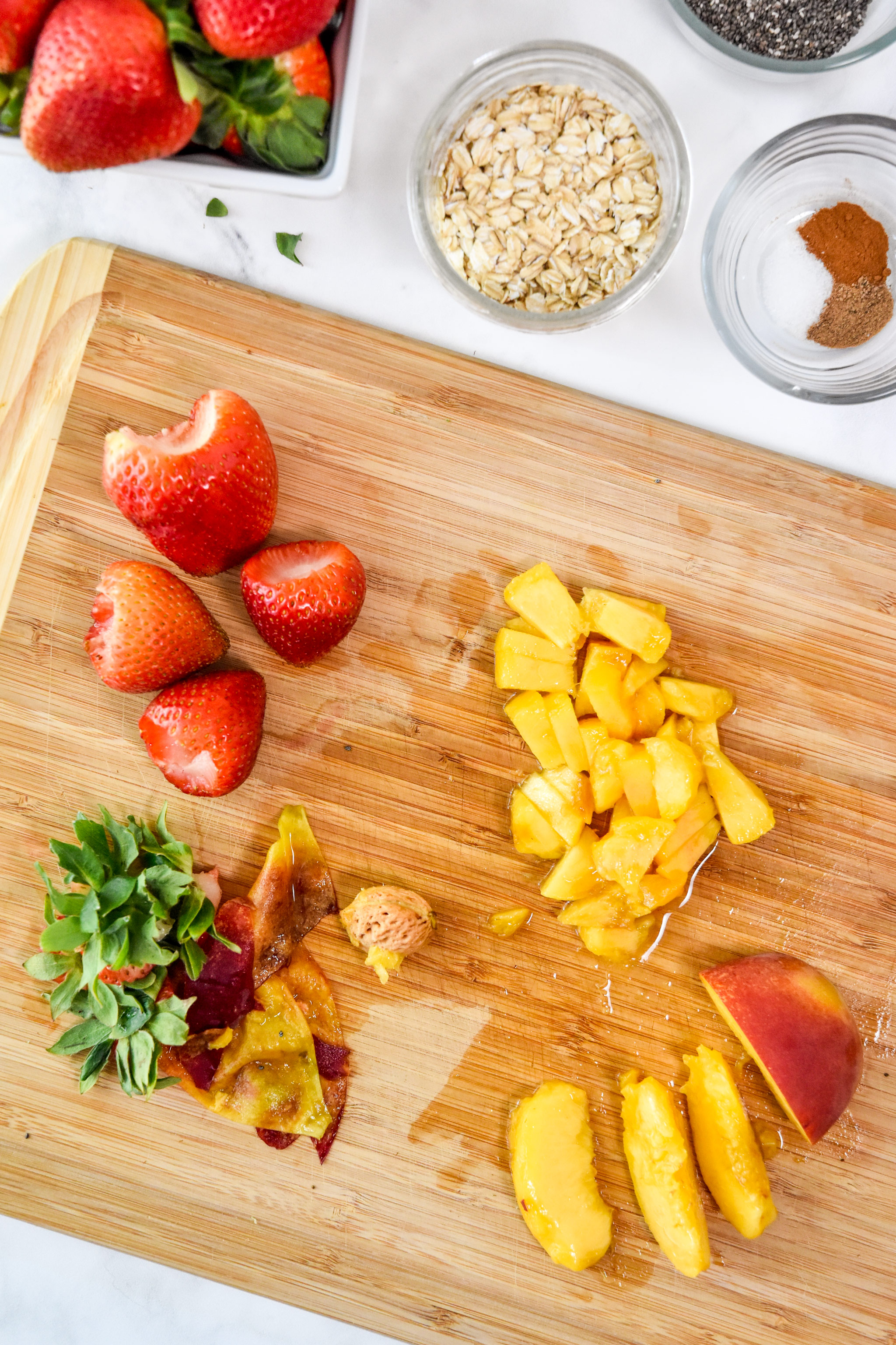 cutting fruit for the strawberry peach overnight oats.
