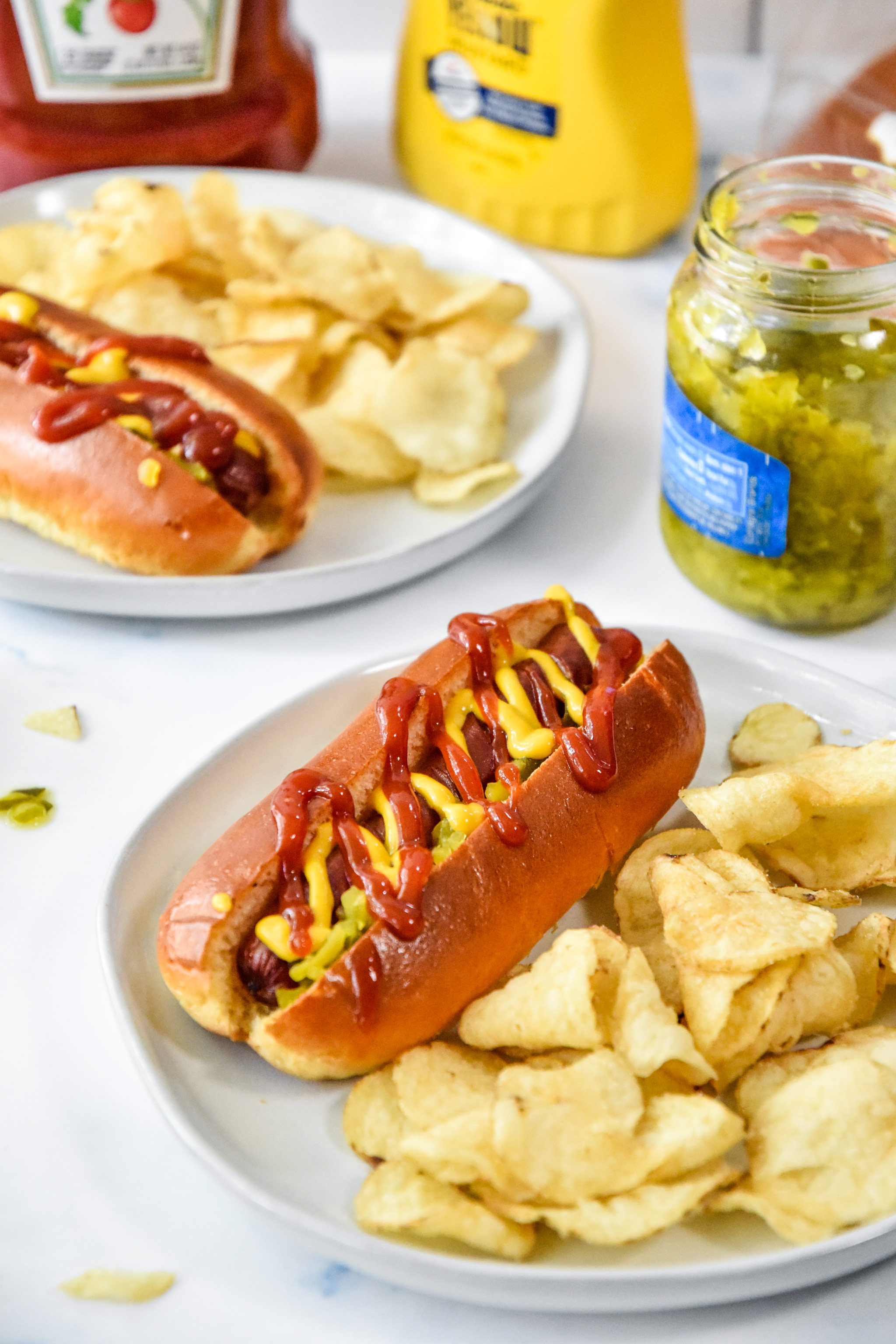 air fryer hot dogs served with chips.