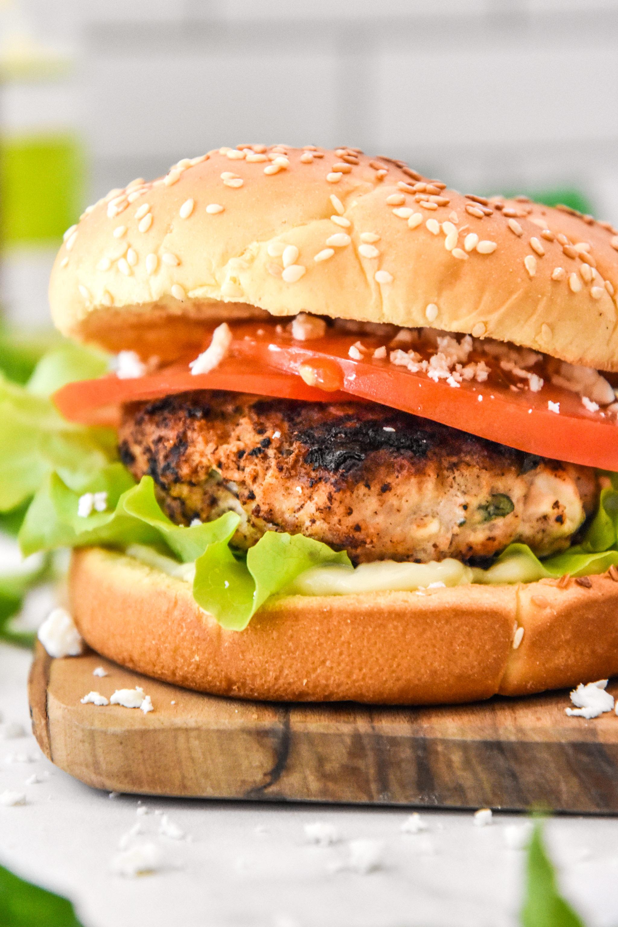 close up of assembled feta basil turkey burger on a bun.