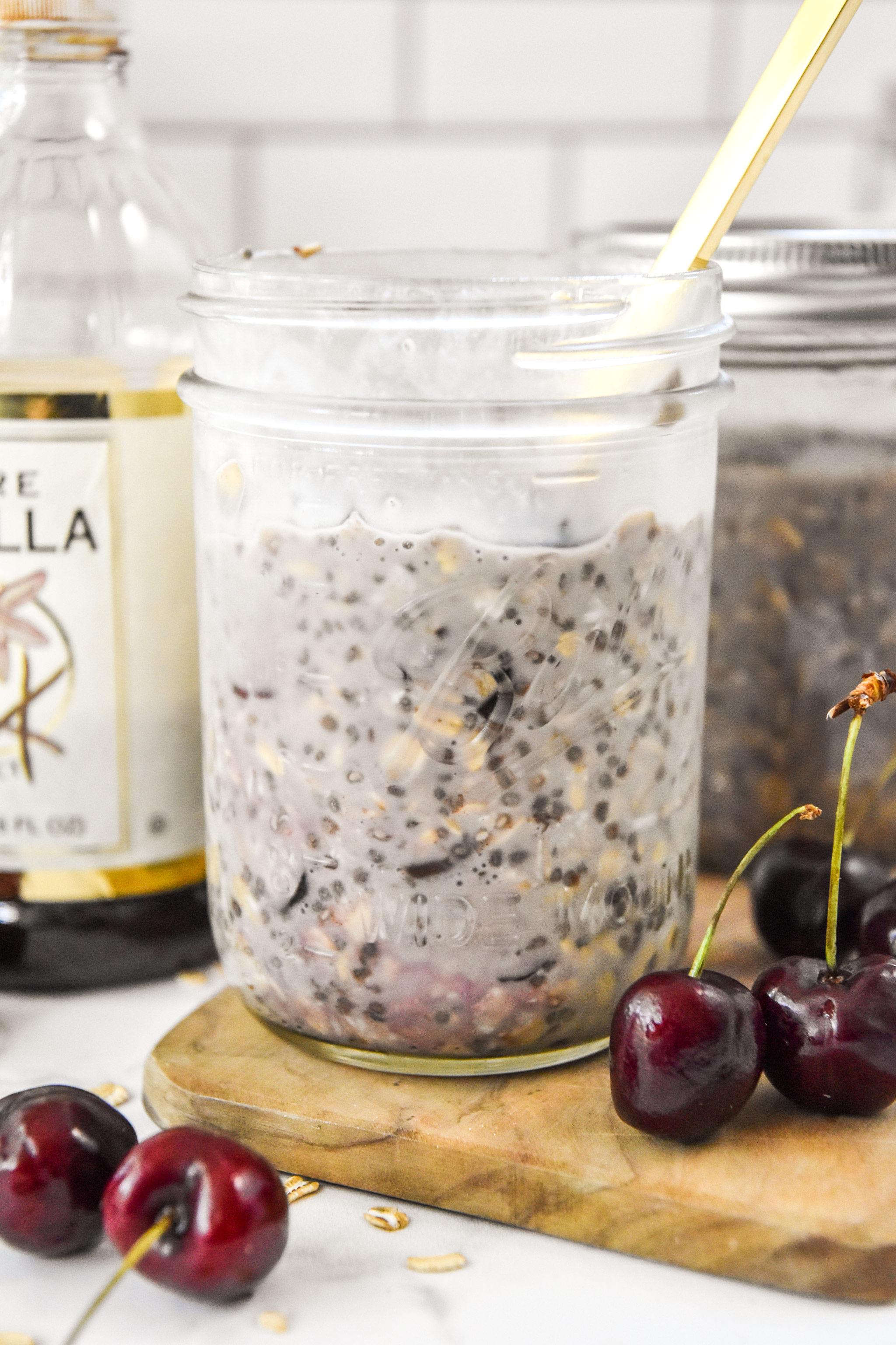 cherry vanilla overnight oats in a mason jar.