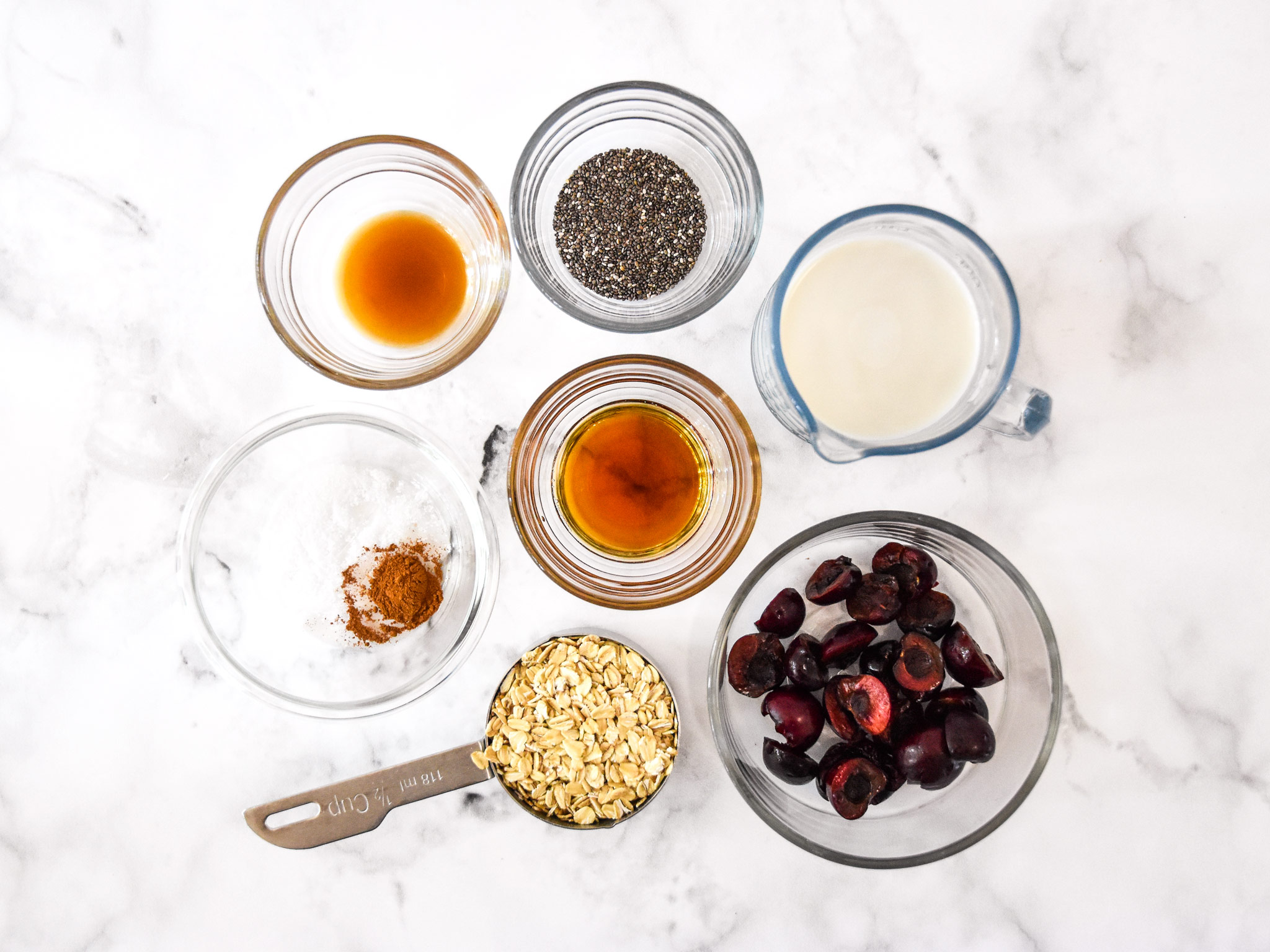 ingredients in bowls for the cherry vanilla overnight oats.