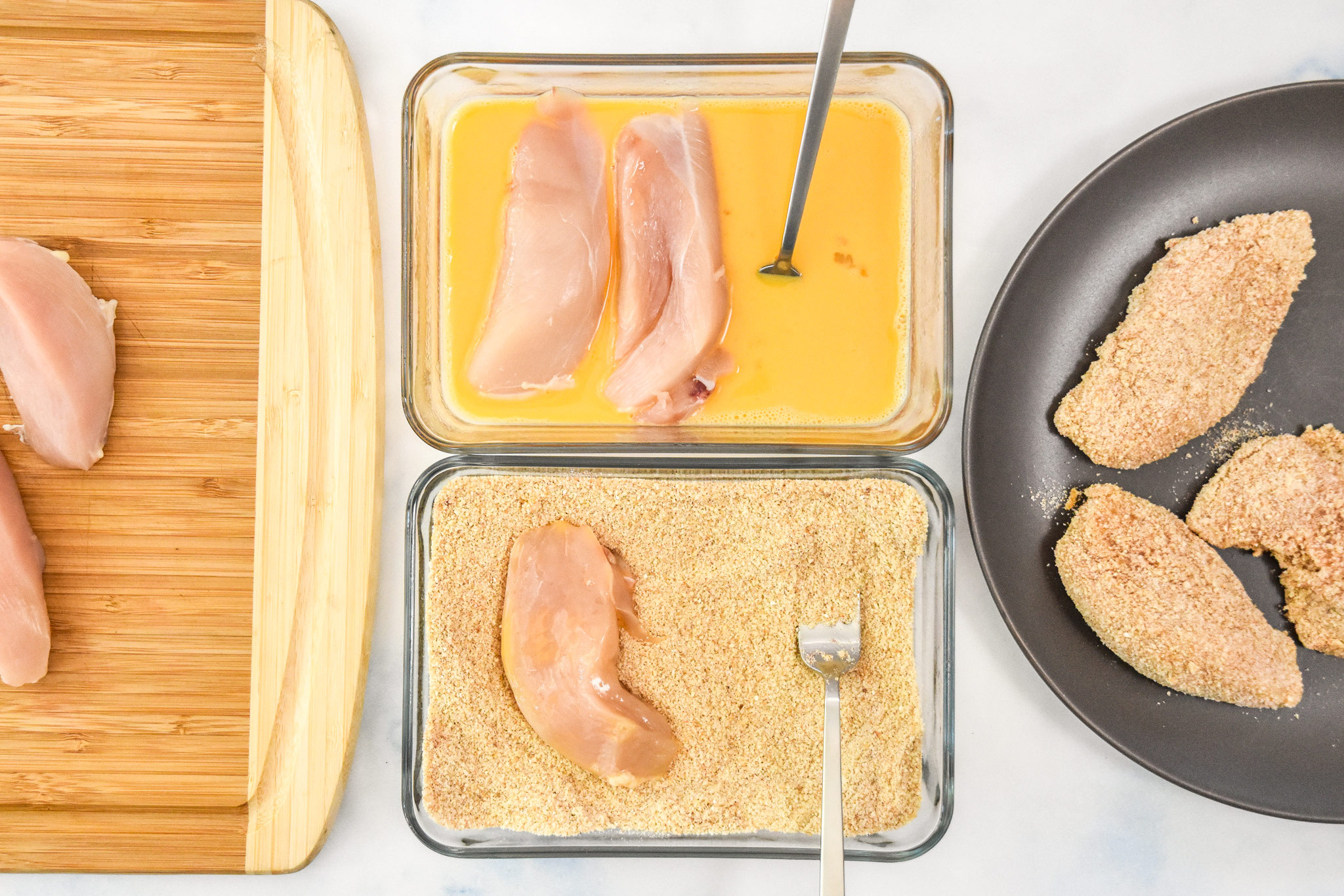 the breading station with an egg bowl and a bread crumb mixture bowl.