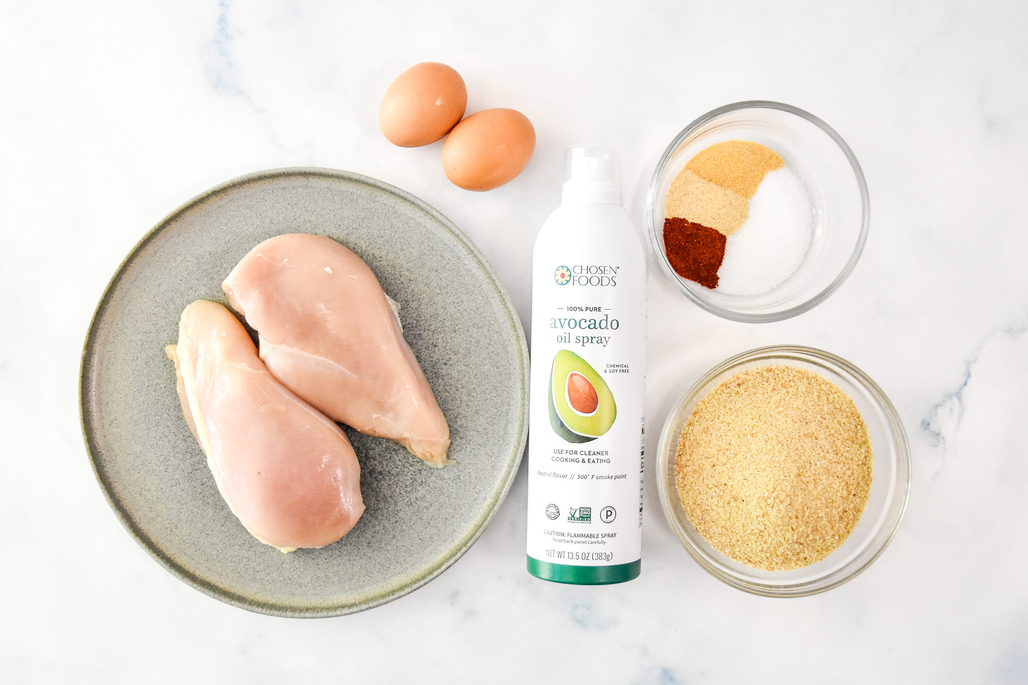 ingredients for the air fryer breaded chicken tenders including raw chicken.