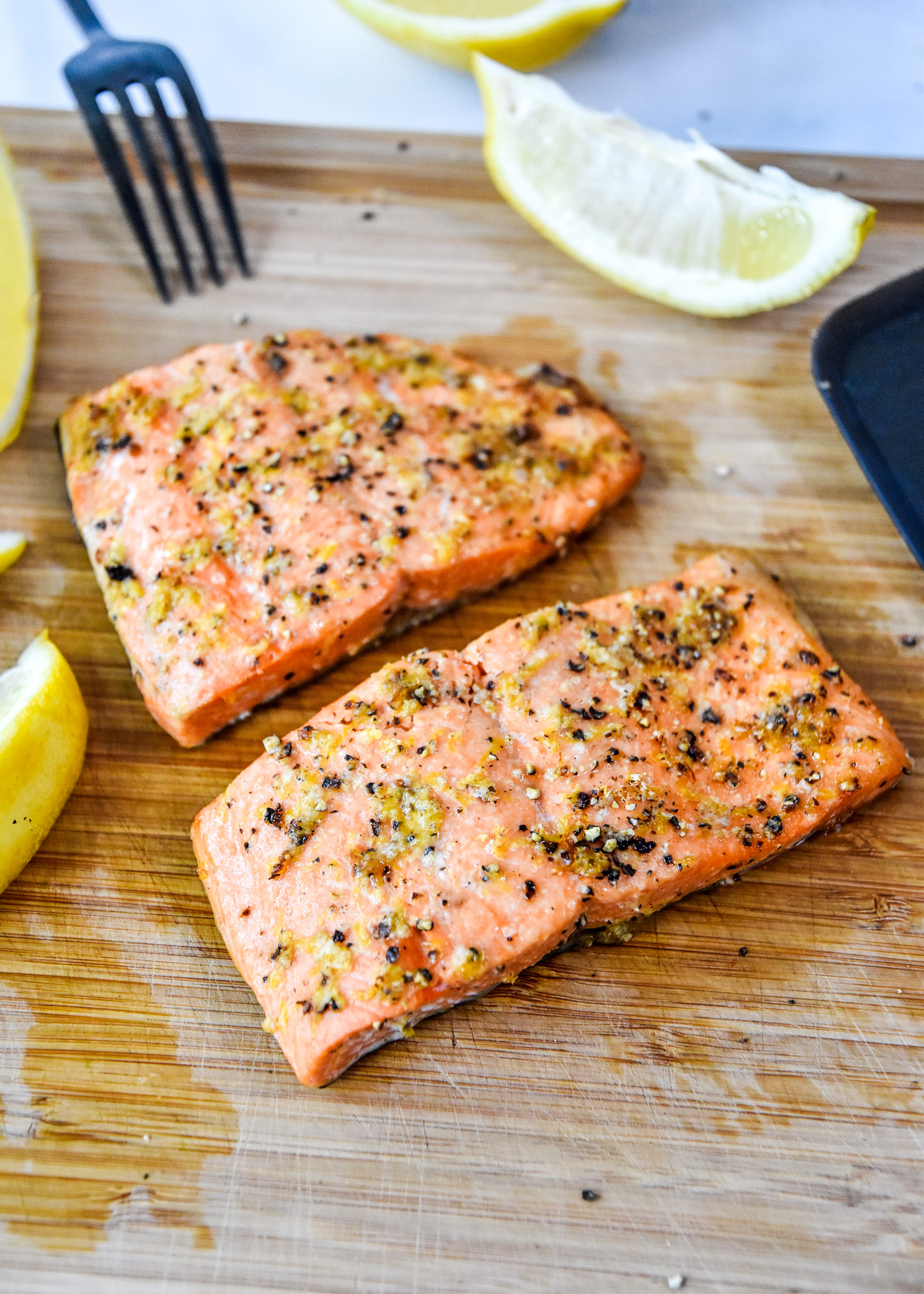 air fryer lemon pepper cooked on a cutting board.