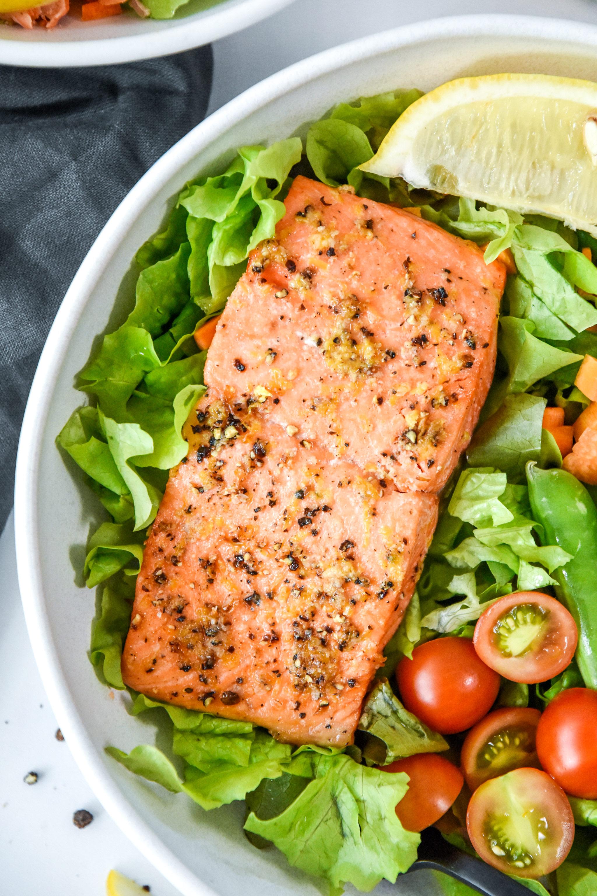 air fryer lemon pepper salmon on a salad.