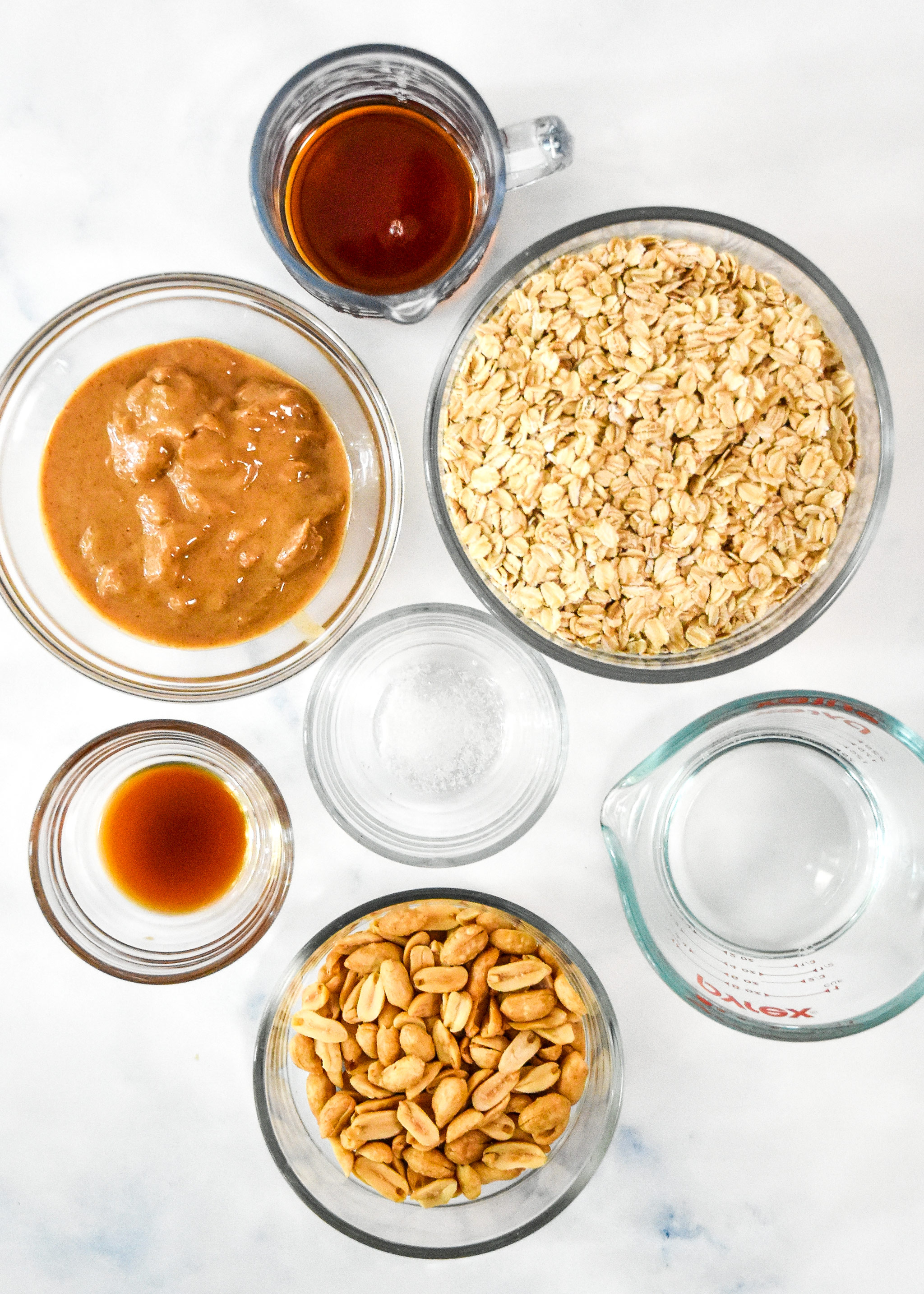 ingredients in glass bowls for the easy peanut butter granola.