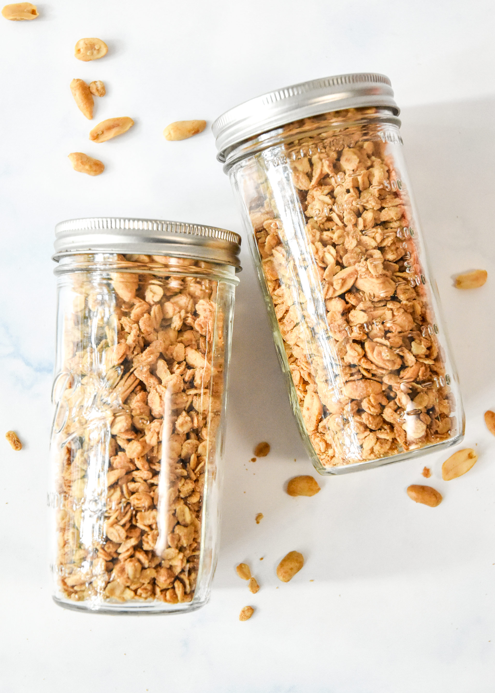 easy peanut butter granola in two large mason jars.