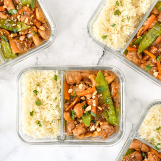 top down shot of easy cashew chicken meal prep in a glass meal prep container with rice.