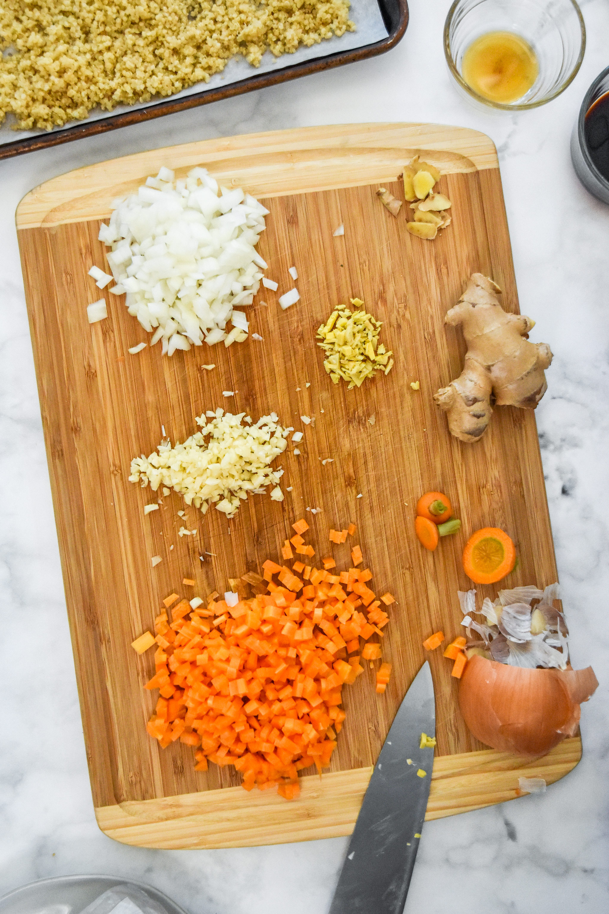 chopped and diced veggie ingredients on a cutting board.