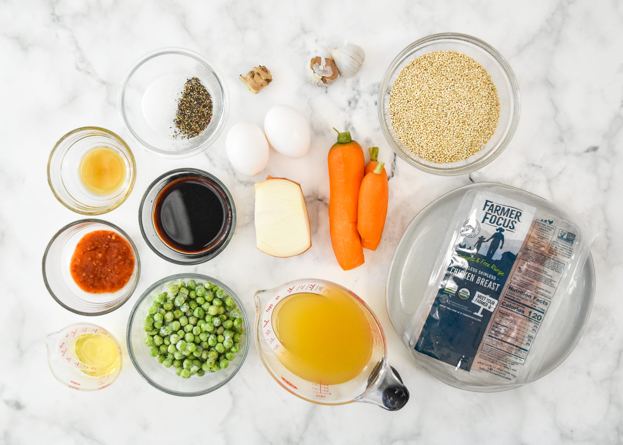 ingredients in the meal prep chicken quinoa fried rice bowls before cooking.