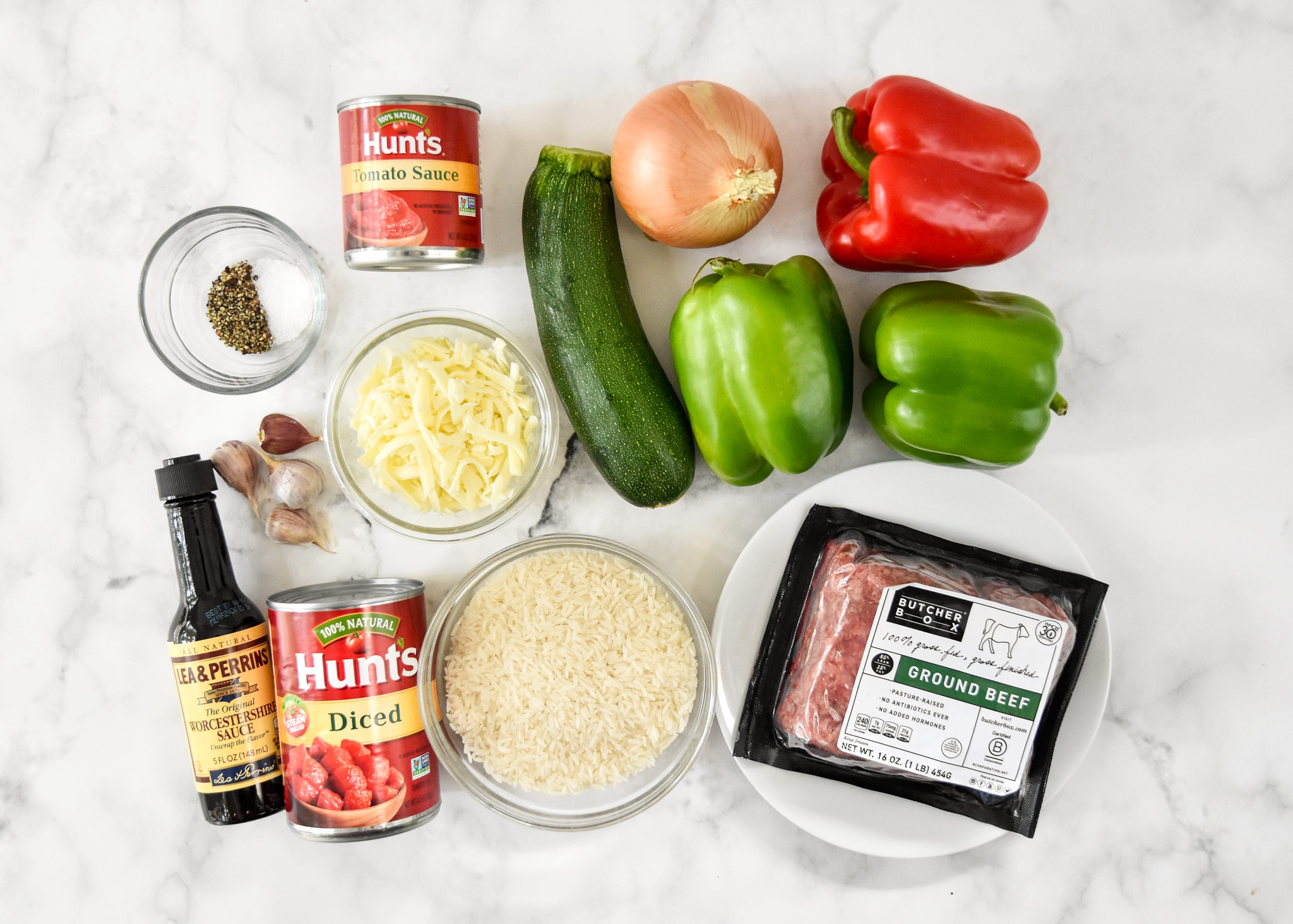 ingredients laid out for the unstuffed pepper bowls including red and green bell peppers.