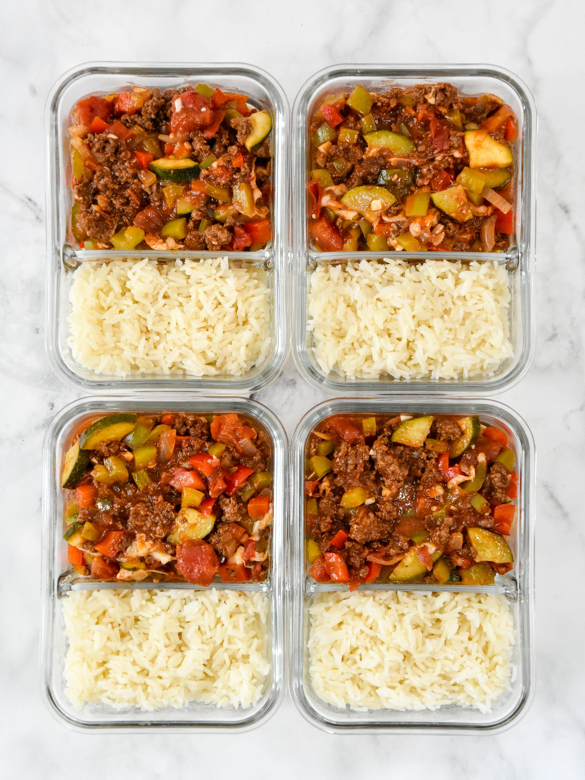 glass containers full of meal prep unstuffed pepper bowls mixture.