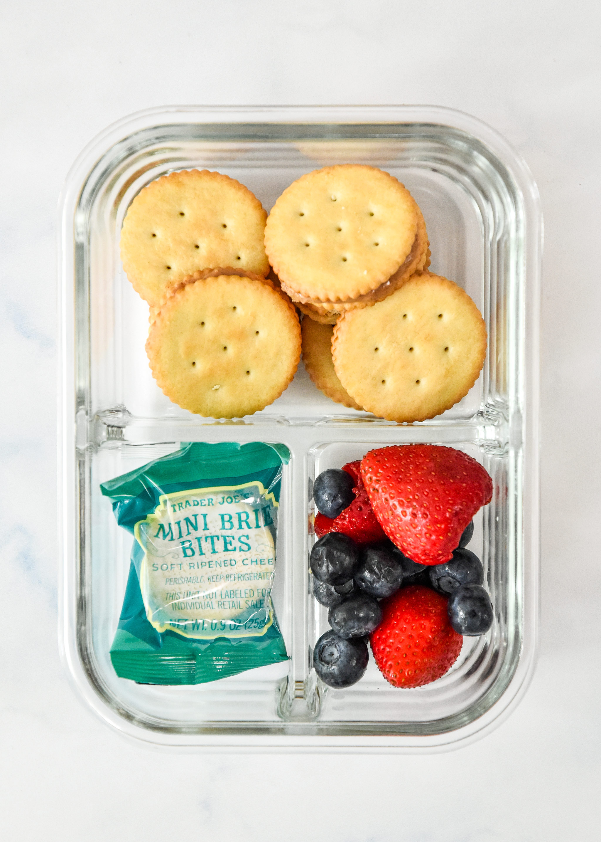 peanut butter cracker sandwiches snack box idea in a meal prep container.