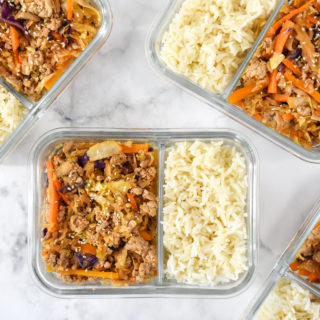 spicy ground turkey cabbage stir fry meal prep in a glass meal prep container.